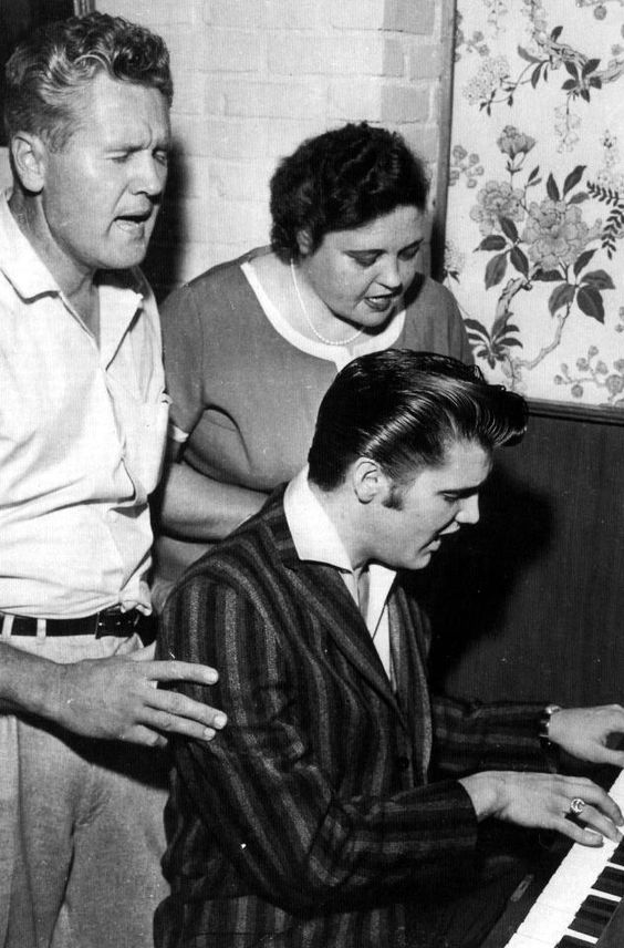 Elvis with his parents singing gospel